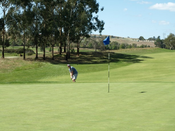 James chipping to the 14th green at Heritage Golf & Country Club St Johns Course