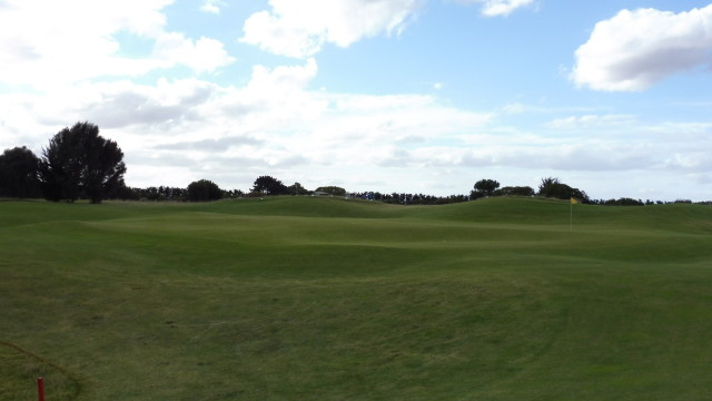 The 15th green at Thirteenth Beach Golf Links Creek Course