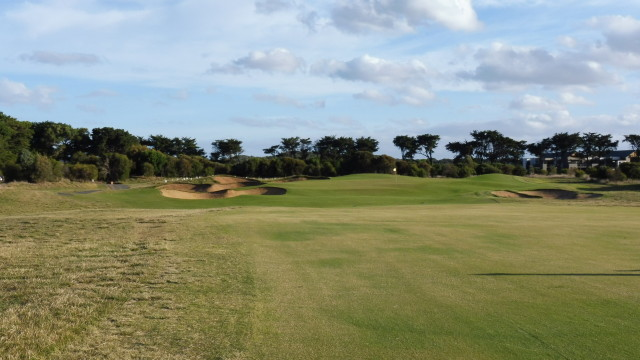 The 18th green at Thirteenth Beach Golf Links Creek Course