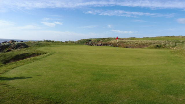 The 11th green at Cape Wickham Links
